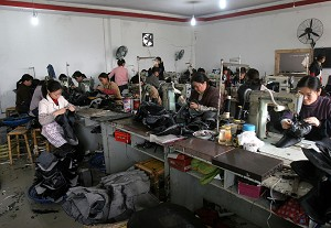"""Workers making shoes in Sichuan Province. In response to criticisms from the world about the quality of products made in China, the Chinese Communist Party (CCP) has begin airing a series of special documentaries in China called """"Believe in Made in China."""" (Getty Images)"""