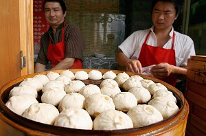 Chinese vendors prepares steaming pork buns on sale at a sidewalk stall in Beijing, July 25, 2007. A former Chinese wholesale food businessman has revealed how contaminated food are sold in Beijing. (Teh Eng Koon/AFP/Getty Images)