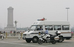 Police cars circling around Tiananmen Square on surveillance at the start of the 17th National Congress of the Chinese Communist Party. (Getty Images)