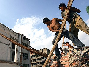 Workers remove remove lumber from a demolished building in Wuhan of Hubei Province, China. (China Photos/Getty Images)