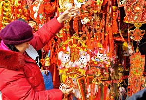 People in Beijing browse for Chinese New Year decoration hangers (The Eng Koon /AFP/Getty Images)