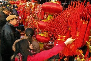 February 5, 2008, Beijing, residents are shopping for decorations. (Teh Eng Koon/AFP/Getty Images)