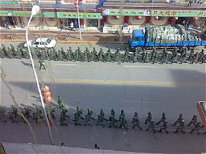 Chinese soldiers move through the streets of Lhasa, trying to maintain control. (Phayul.com)