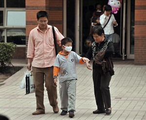 A child leaves a children's hospital in Beijing on May 7, 2008. The number of children confirmed to have died from a highly contagious virus in China has risen to 28 as authorities warned May 7 a 'mass outbreak' across the country was looming. (Peter Parks/AFP/Getty Images)