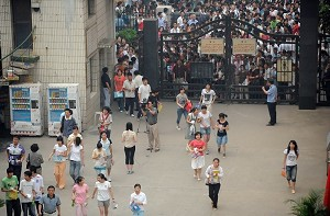 Chinese students arrive at a test site in Hefei City, Anhui Province, with their parents, to sit the national college entrance exams June 7, 2008. (AFP/Getty Images)