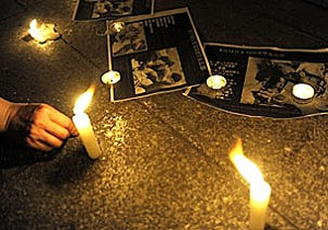 Candles and photos mark this impromptu shrine to Sichuan eartquake victims.