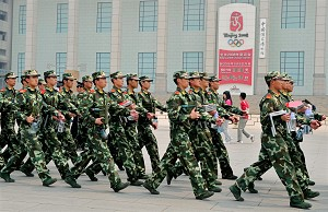 Chinese paramilitary policemen patrol past the Beijing Olympics countdown clock on the edge of Tiananmen Square in Beijing. (Teh Eng Koon/AFP/Getty Images)