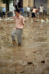 A man walking in the mud after the flood in Lechang city, Guangdong province, China. (AFP)