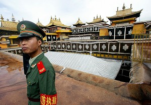A Chinese paramilitary policeman guards the roof top of the Potala Palace, in Lhasa. (Goh Chai Hin/AFP/Getty Images)