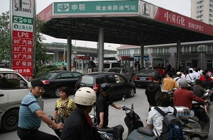 Motorcyclists queue to buy fuel at a petrol station on June 6, 2008 in Shanghai, China. On June 19, China's Commission for State Reform and Development issued a notice that beginning on June 20, the cost of domestic refined oil and electricity would be raised. (China Photos/Getty Images)