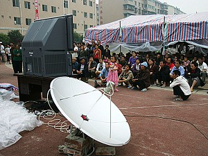 A satellite television is installed for earthquake survivors at a temporary shelter in Mianyang of Sichuan Province, China. With NTDTV blocked, Chinese citizens are no longer able to watch uncensored news inside China. (China Photos/Getty Images)