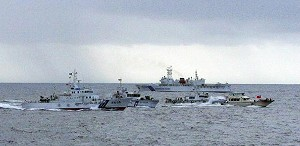 Patrol boats of Japan Coast Guard warn a Taiwanese boat (R/with a red flag) heading for the disputed islands in the East China Sea known as the Senkaku in Japanese and the Diaoyu in Chinese. (AFP/Getty Images)