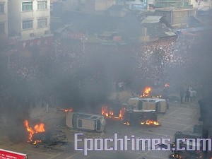 Dozens of police vehicles were rolled over and set on fire by protesters. (The Epoch Times)