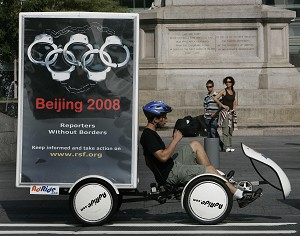 Bikers with mobile billboards from the Reporters Without Borders group launch an international campaign in New York 07 August 2007 on the 2008 Summer Olympic Games in Beijing. In the run-up to Olympics, the Communist Regime has tightened its grip on oppressed groups such as Falun Gong. (Timothy A. Clary/AFP/Getty Images)