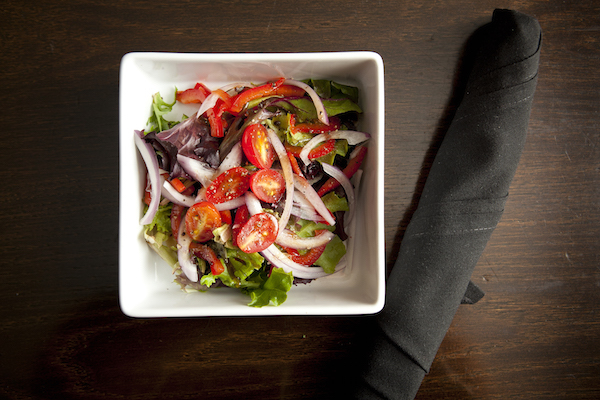 A simple but delicious salad, with slivers of sweet red peppers, red onions, and cherry tomatoes a sweet and tangy dressing. (Samira Bouaou/Epoch Times)