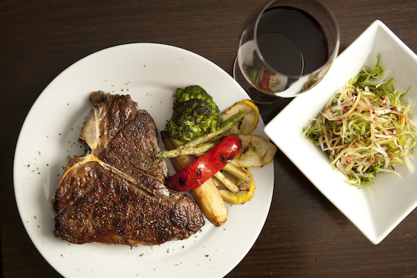 Grilled Porterhouse steak with side vegetables. (Samira Bouaou/Epoch Times)
