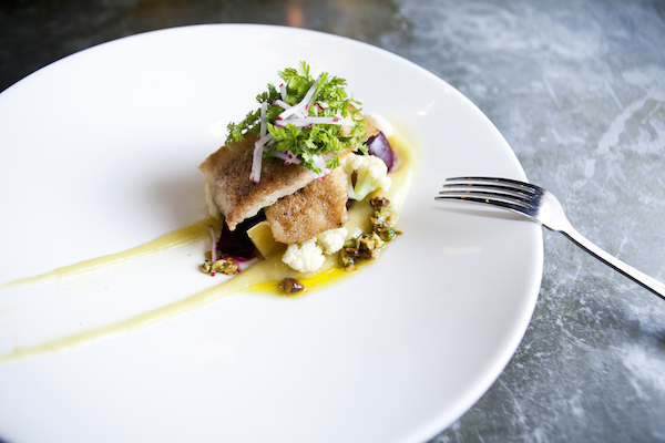 Black cod with sweet onion puree, roasted beets, cauliflower, and pistachio vinaigrette. (Samira Bouaou/Epoch Times)