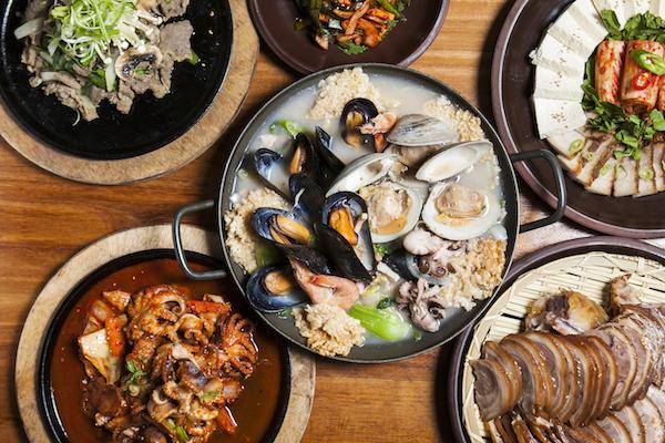 An assortment of dishes at Soju Haus, center: mild seafood stew. (Samira Bouaou/Epoch Times)