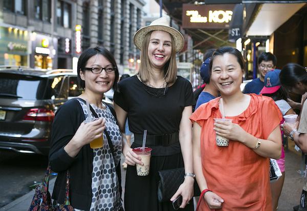 (L–R) Anna Takaoka, Maria Zyablitskaya, and  Suyouyang Kim sip bubble tea from Gong Cha. (Samira Bouaou/Epoch Times)