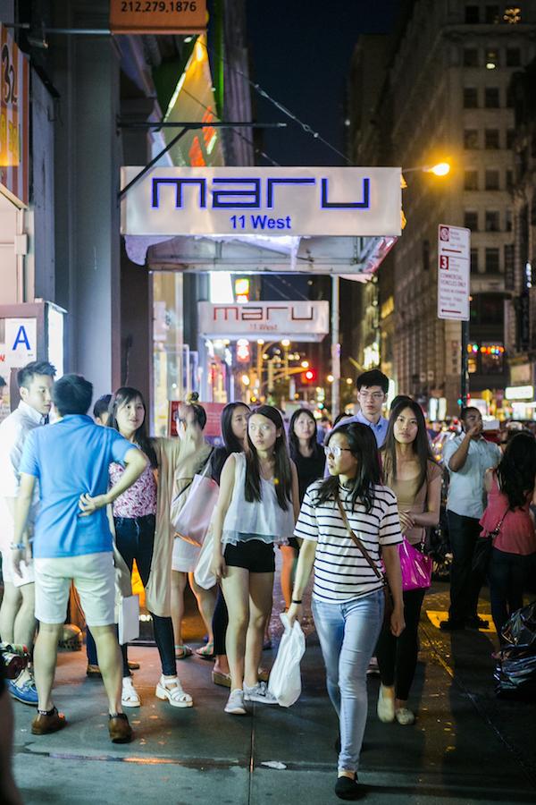 People walking down the bustling streets of Koreatown. (Samira Bouaou/Epoch Times)