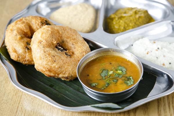 Medhu vadai with coconut,  lentil, fenugreek chutneys, and sambhar. (Samira Bouaou/Epoch Times)