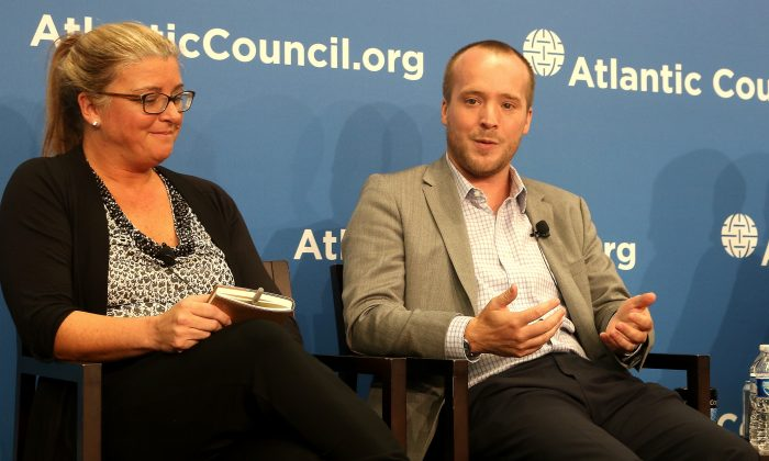 Catherine Lotrionte (l), director, Institute for Law, Science, and Global Security, Georgetown University and Robert Knake, fellow, Council on Foreign Relations. They discussed the cyberattack on OPM at the Atlantic Council, Aug. 19. (Gary Feuerberg/ Epoch Times)