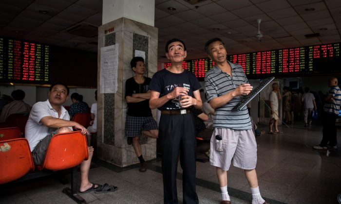 Investors monitoring stock market movements at a brokerage house in Shanghai on Aug. 18, 2015. (Johannes Eisele/AFP/Getty Images)