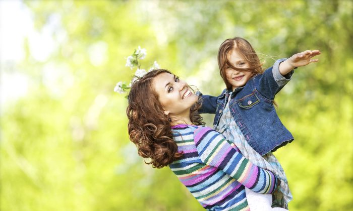 After a hard day at work, children still expect their mom to spend quality time with them. (FotoimperiyA/iStock)