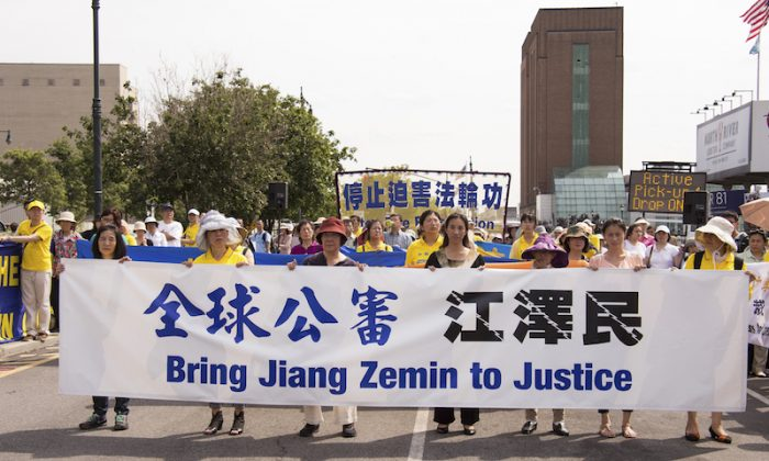 Falun Gong practitioners at a rally in front of the Chinese embassy in New York City on July 3, 2015, to support the global effort to sue Jiang Zemin. (Larry Dye/Epoch Times)