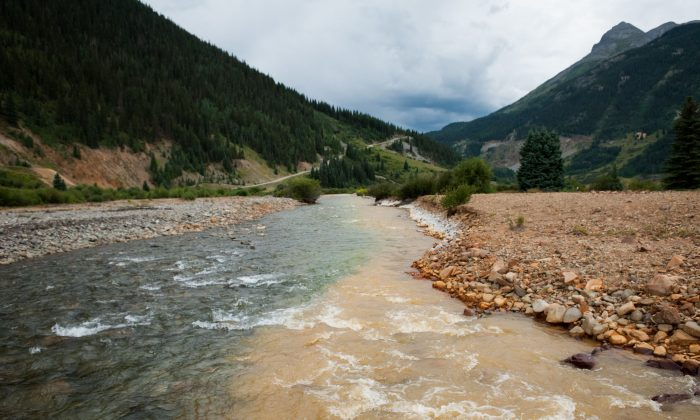 Cement Creek, which was flooded with millions of gallons of mining wastewater, meets with the Animas River in Silverton, Colorado, on Aug. 11, 2015. The Environmental Protection Agency accidentally released approximately three million gallons of wastewater into the creek from the Gold King Mine, polluting the larger Animas River downstream. (Theo Stroomer/Getty Images)