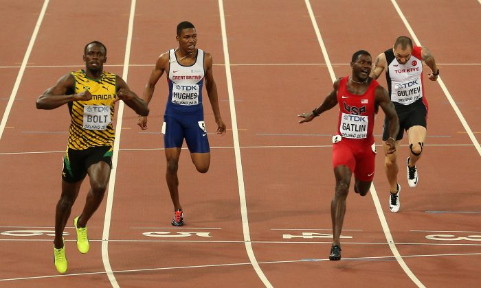 Usain Bolt of Jamaica crosses the finish line to win gold ahead of Justin Gatlin (2nd R) of the United States in the Men's 200 metres final during day six of the 15th IAAF World Athletics Championships Beijing 2015 at Beijing National Stadium on August 27, 2015 in Beijing, China. (Patrick Smith/Getty Images)