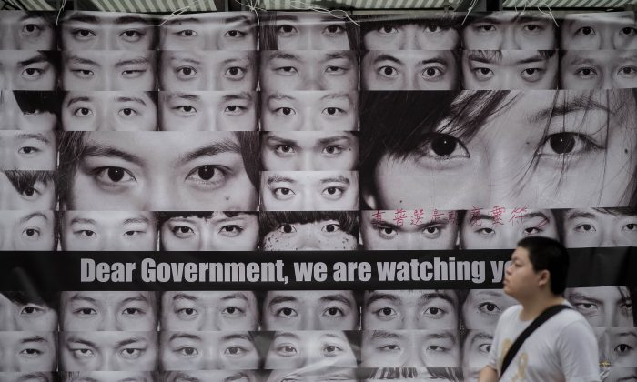 Posters showing pictures of the eyes of pro-democracy protesters are displayed in the Admiralty district of Hong Kong on Nov 11, 2014. (Philippe Lopez/AFP/Getty Images)