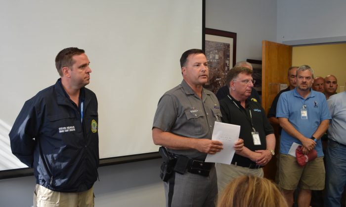 (L-R) Orange County Executive, Steve Neuhaus;  New York State Police Captain, Brendan Casey; Stewart International Airport Manager ,Ed Harrison; at a press conference after the death of a pilot at Stewart International Airport  in New Windsor, N.Y. on Aug. 28, 2015. (Yvonne Marcotte/Epoch Times).