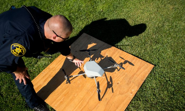 Alameda County Sheriff's Deputy Dave Durbin prepares to fly a drone during a demonstration of a search and rescue operation in Dublin, Calif., on Aug. 14, 2015. (AP Photo/Noah Berger)