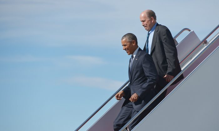 U.S. President Barack Obama steps off Air Force One with Alaska Governor Bill Walker upon arrival at Elmendorf Air Force Base  in Anchorage, Alaska, on August 31, 2015. (Mandel Ngan/AFP/Getty Images)