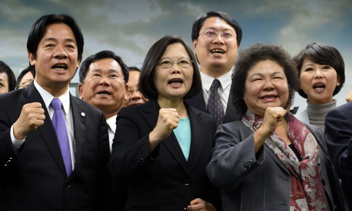 Tsai Ing-wen (C), chairwoman of Taiwan's main opposition Democratic Progressive Party (DPP), gestures with party members during a press conference in Taipei on April 15. The Chinese regime is holding military drills simulating invasions of Taiwan, ahead of the Taiwanese presidential elections. (SAM YEH/AFP/Getty Images)