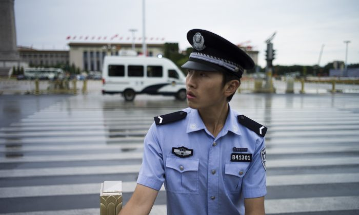 A Chinese policeman checks an entrance to Tiananmen Square in Beijing on September 1, 2015, prior to a military parade to be held on September 3 to mark the victory over Japan and the end of World War II. (Fred Dufour/AFP/Getty Images)