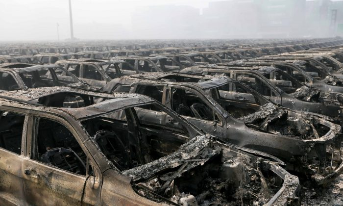 Brand new cars parked in Tianjin port are seen badly damaged at the site of the massive explosions in Tianjin on Aug. 13, 2015.  (STR/AFP/Getty Images)