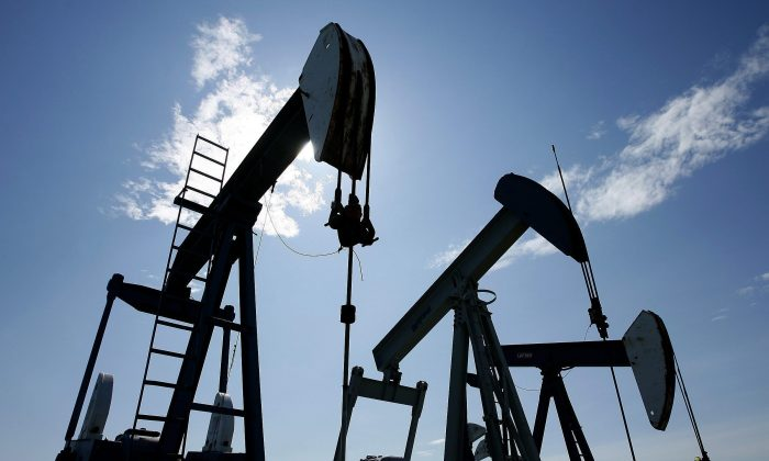 Pumpjacks at work near Halkirk, Alta. in this file photo. The fall in business investment in the oil patch had a big impact on Q2 GDP in Canada. (The Canadian Press/Larry MacDougal)