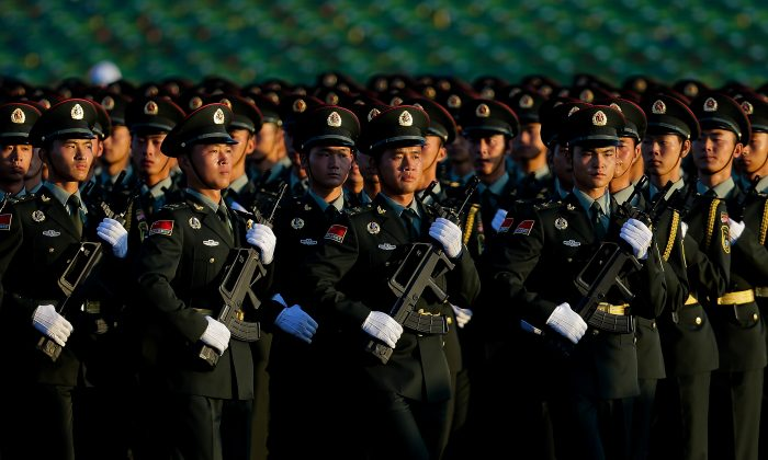 Chinese People's Liberation Army troops practice marching as they arrive at Tiananmen Gate for a military parade to commemorate the 70th anniversary of the end of the World War II in Beijing Thursday Sept. 3, 2015. (AP Photo/Andy Wong)