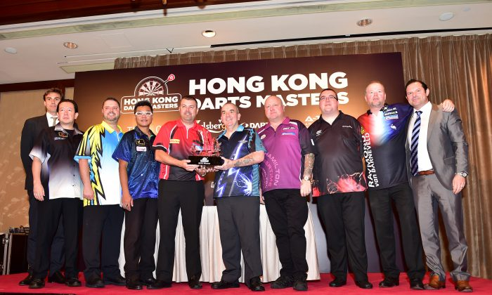 (L-R) Rob Derry, MD Ironmonger Events; Scott Mackenzie, Isen Veljic, Royden Lam, Wes Newton, Phil Taylor, Andy Hamilton, Stephen Bunting, Raymond Van Barneveld and PDM Events Partner Craig Mather. (Bill Cox/Epoch Times)
