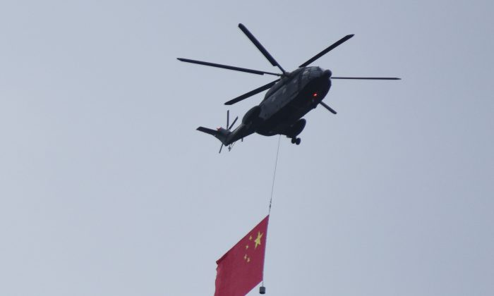 A Chinese military helicopter flies over the city during a rehearsal ahead of the Sept. 3 military parade to mark the 70th anniversary of the victory over Japan in WWII.  (ChinaFotoPress/ChinaFotoPress via Getty Images)