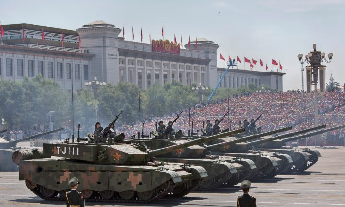 Chinese soldiers ride in tanks as they pass in front of Tiananmen Square during a military parade in Beijing on Sept. 3, 2015. (Kevin Frayer/Getty Images)