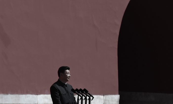 Chinese President Xi Jinping (C) prepares to review the People's Liberation Army (PLA) troops from a car during a military parade to mark the 70th anniversary of the end of World War Two on September 3, 2015 in Beijing. (Wang Zhao - Pool /Getty Images)