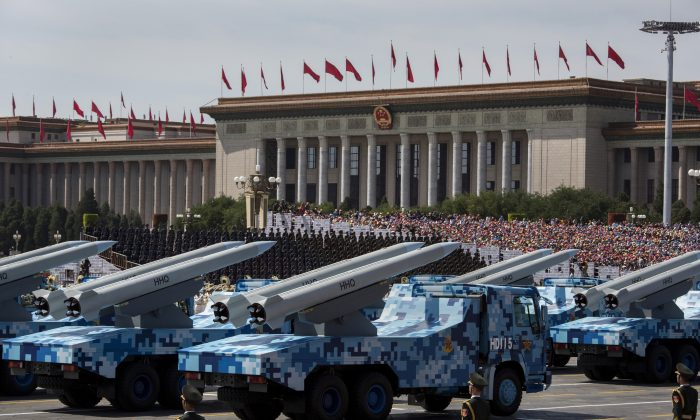 Chinese missiles are paraded on trucks near Tiananmen Square during a military parade in Beijing on Sept. 3, 2015. (Kevin Frayer/Getty Images)