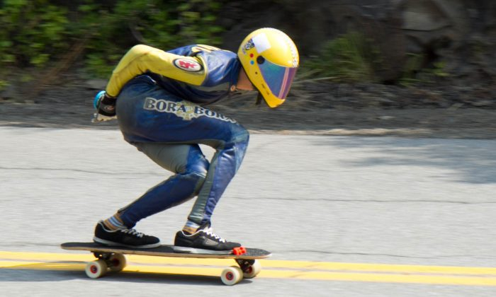 A skateboarder goes down Skyline Drive at Elks Brox Memorial Park in Port Jervis on Sept. 4, 2015 during the ACME Downhill Longboard and Luge Show. (Holly Kellum/Epoch Times)