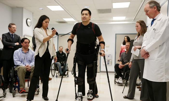 Forty three-year-old parapalegic Robert Woo walks with an exoskeleton device made by Ekso Bionics during a demonstration at the opening of the Rehabilitation Bionics Program at Mount Sinai Rehabilitation Center on December 6, 2012 in New York City. (Mario Tama/Getty Images)
