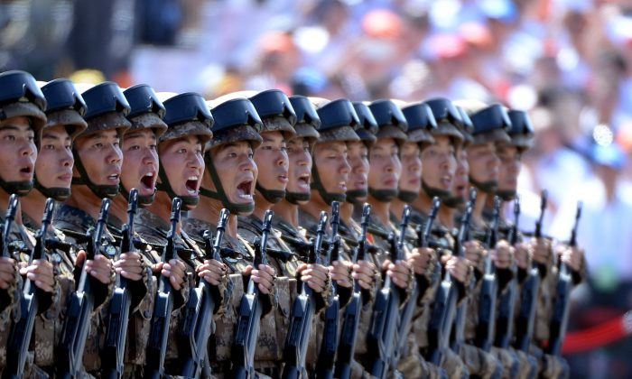 Chinese soldiers march in formation during a military parade in Tiananmen Square in Beijing on September 3. (Wang Zhao/AFP/Getty Images)