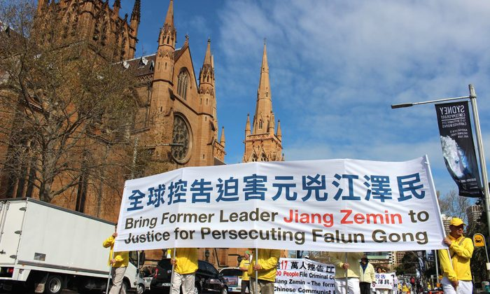 Falun Gong practitioners march in a parade in Sydney on Sept. 4, 2015, calling for an end to the persecution launched by the former Communist Party leader Jiang Zemin. (Epoch Times)
