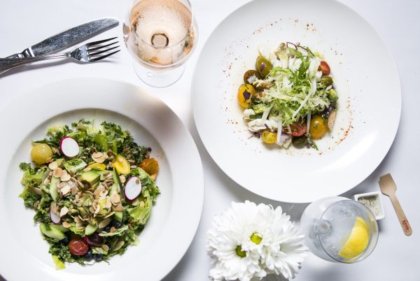 Salad of the day, with king crabmeat and tomatoes (R); and Georgette's Salad, with kale, quinoa, and blueberries. (L) (Samira Bouaou/Epoch Times)